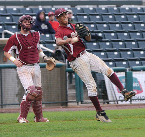 lowell: The Newburyport's Drew Carter makes a play on a bunt during the Clippers  3-1 victory over St Mary's  in the Division 3 North Sectional Championship game at LeLacheur Park in Lowell Saturday. Jim Vaiknoras/Staff photo