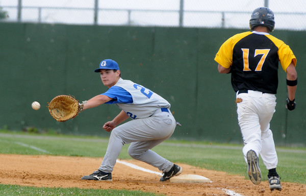 Lowell: Georgetown first baseman Adam Johnson fields a throw to get out a Northeast player during the Royals 8-3 victory at Alumni Field in Lowell. Jim Vaiknoras/staff photo