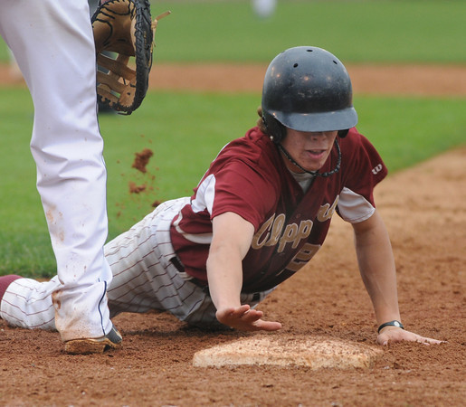 Lowell: Newburyport's Dave Cusack dives safely back to first during the Clippers 3-1 victory over St Mary's in the North Sectional Championship game at LeLacher Park in Lowell. Jim Vaiknoras/Staff photo