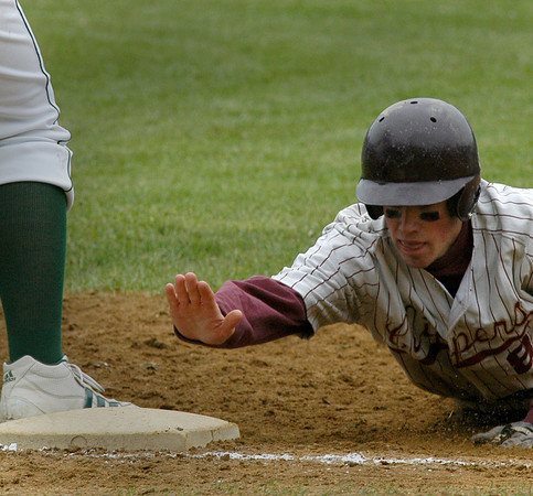 Newburyport: <br /> Newburyport's Conor Clancy dives back safely back to first vs North Reading.<br /> Photo by Jim Vaiknoras/Newburyport Daily News. Saturday, May 21, 2005