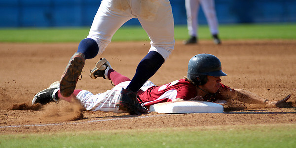 Lynn: Newburyport lead off hitter, Dave Cusack (12), slides safely back to first base on a pick off attempt early in Wednesday 4-1 win over Apponequet. Photo by Ben Laing/Staff Photo