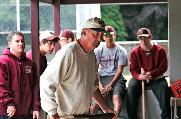Newburyport: Long time coach of the Newburyport baseball team, Bill Pettingill, talks with his team during Friday's practice, as they go over last minute details for Saturday's North Sectional Championship game against Georgetown. Photo by Ben Laing/Staff Photo<br /> , Newburyport: Long time coach of the Newburyport baseball team, Bill Pettingill, talks with his team during Friday's practice, as they go over last minute details for Saturday's North Sectional Championship game against Georgetown. Photo by Ben Laing/Staff Photo