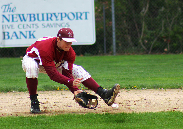 Newburyport: Matt Mattola (10), second baseman for the Clippers, scoops up a ground ball during Monday's game between Newburyport and Rockport at Newburyport High School. Photo by Ben Laing/Staff Photo