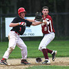 Newburyport: Newburyport shortstop Colby Morris (9) looks to the umpire after applying a tag to an Amesbury baserunner on a pick off attempt at second base Tuesday afternoon. Photo by Ben Laing/Staff Photo