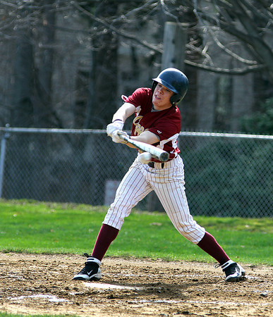 Newburyport: Newburyport's Dave Cusack (12) knocks a ground ball into the infield during Thursday's game against North Reading at Newburyport High School. Photo by Ben Laing/Staff Photo