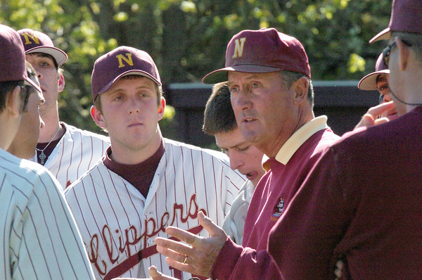 Newburyport: <br /> Newburyport baseball coach Bill Pettingell conferences his team between innings yesterday at the Lower Field as they hosted Pentucket.<br /> Photo by Bryan Eaton/Newburyport Daily News. Thursday, May 12, 2005