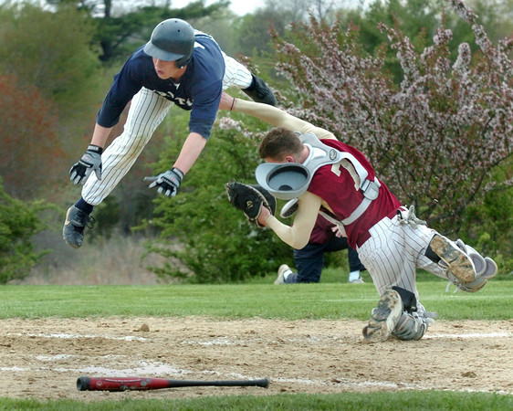 Byfield: <br /> Triton's Bylan Burke flies over Newburyport catcher Jared Notargiacomo yesterday in Byfield. Burke was deemed out in the contoversial call.<br /> Photo by Bryan Eaton/Newburyport Daily News. Tuesday, May 17, 2005