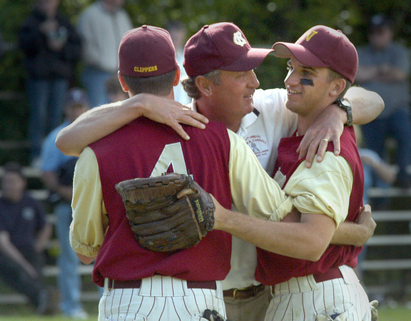 Georgetown: <br /> Newburyport High baseball coach Bill Pettingell is congradulated by players John Gavin and Mike McCormack after winning his 500th career victory.<br /> Photo by Jim Vaiknoras/Newburyport Daily News. Saturday, June 5, 2004