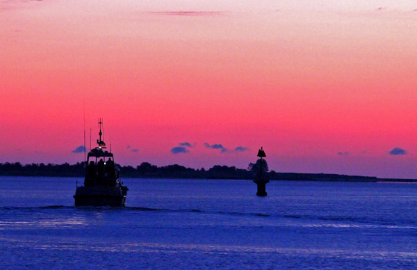 Newburyport: As the sun rises over the mouth of the Merrimack River Friday morning, a lone fishing boat heads out to make its catch. Photo by Ben Laing/Staff Photo
