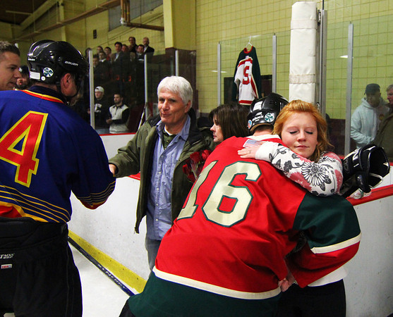 Newburyport: Teammates honor Daniel Nikas before their hockey game Thursday night at the Graf Rink. Photo by Ben Laing/Staff Photo