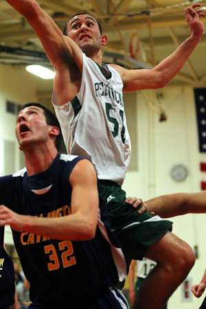 Amesbury: Pentucket's Will Angelini (51) leaps over Arlington Catholic's Robert Wesoloski (32) during Tuesday nights game in Amesbury. The Sachems won 55-53 in the first round of the state tournament. Photo by Ben Laing/Staff Photo