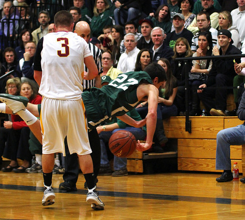 Byfield: Mike Doud (22) of Pentucket dives out of bounds to save a loose ball during Tuesday night's 53-39 loss to Newburyport in the semi final round of the state tournament. Photo by Ben Laing/Staff Photo