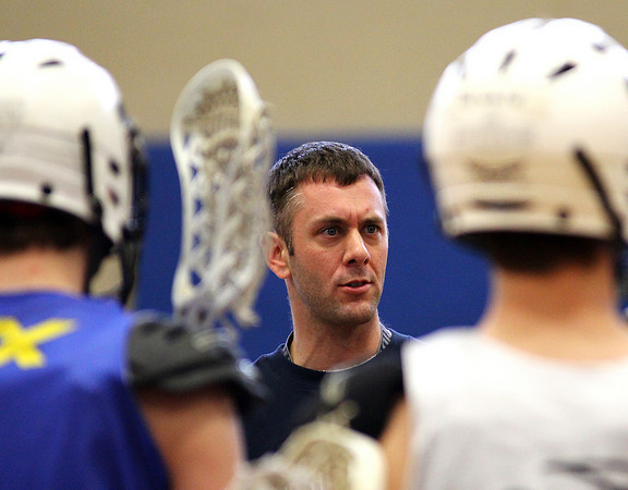 Byfield: Sean Parsons, the new boys lacrosse coach at Triton, addresses his players before practice Tuesday afternoon. Photo by Ben Laing/Staff Photo