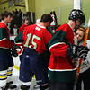Newburyport: Teammates honor Daniel Nikas before their hockey game Thursday night at the Graf Rink. Photo by Ben Laing/Staff Photo