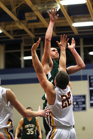 Byfield: Pentucket's Will Angelini (51) shoots over Newburyport's Matt Mattola (22) duirng Tuesday night's state semi final match up at Triton. The Clippers would go on to win 53-39. Photo by Ben Laing/Staff Photo