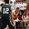 Byfield: Newburyport's Matt Leavitt (3) scans the Pentucket defense during Tuesday night's 53-39 win over the Sachems in the semi final round of the state tournament. Photo by Ben Laing/Staff Photo