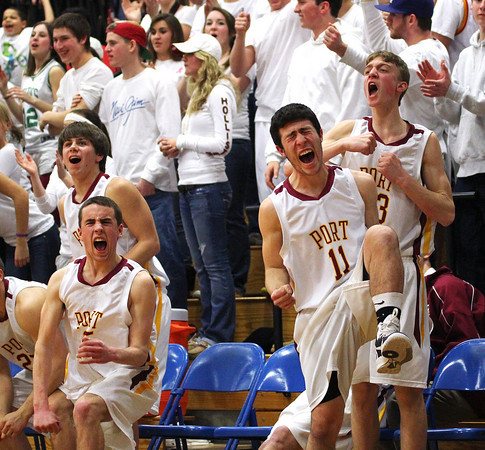Byfield: The Newburyport bench erupts after scoring a basket late in the fourth quarter of Tuesday night's 53-39 win over Pentucket in the state semi final game at Triton. Photo by Ben Laing/Staff Photo