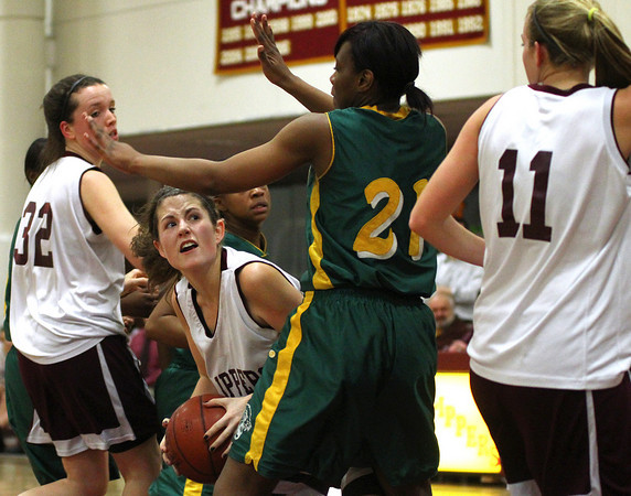 Newburyport: Newburyport's Molly Rowe (12) battles in the paint during Wednesday night's game against Snowden. Photo by Ben Laing/Staff Photo