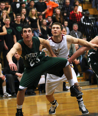 Byfield: Pentucket's Nick Giannino (23) battles for position with Newburyport's Matt Mattola (22) during Wednesday nights state tournament semi final game at Triton High School. The Clippers won, 53-39. Photo by Ben Laing/Staff Photo
