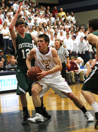 Byfield: Pentucket's Corey McNamara (12) tries to cut off Chris Jayne's (5) route to the basket as Jayne's Clippers defeated the Sachems 53-39 in the semi final round of the state tournament Wednesday night. Photo by Ben Laing/Staff Photo