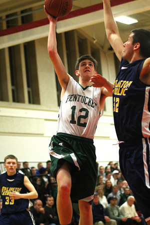 Amesbury: Pentucket's Corey McNamara (12) shoots a ball over an Arlington Catholic defender during Tuesday night's 55-53 win in the first round of the state tournament. Photo by Ben Laing/Staff Photo