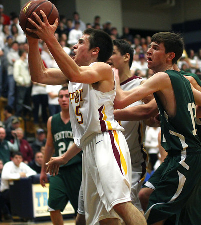 Byfield: Newburyport's Chris Jayne (5) slices through the Pentucket defense Tuesday night, helping his team to a 53-39 victory in the semi final game of the state tournament. Photo by Ben Laing/Staff Photo