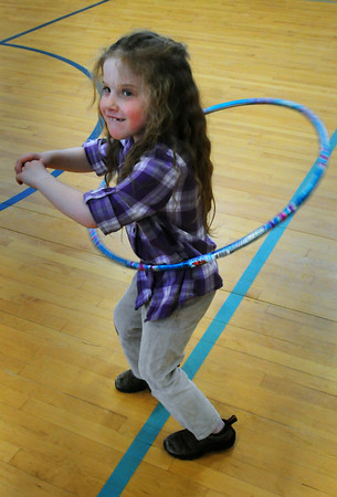 Salisbury: Emma Sullivan, 6, sees how long she can go on a hula hoop try at Salisbury Elementary School on Wednesday. She was in Teresa Griffin's hula hoop class in the afterschool Explorations Program. Bryan Eaton/Staff Photo