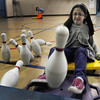"Rowley: Sara Winnick, 8, smashes into some plastic bowling pins at the Pine Grove School in Rowley on Thursday morning. The students were playing ""human bowling"" one of the more popular activities in gym class. Bryan Eaton/Staff Photo"