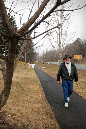 Amesbury: Richard Gale walks by trees he planted seven years ago on Route 110 in Amesbury, just west of the Main Street intersection near Cumberland Farms. Bryan Eaton/Staff Photo