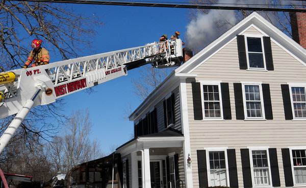 West Newbury: West Newbury firefighters attended to a chimney fire at 374 Main Street yesterday morning, only a hundred yards from their headquarters. Bryan Eaton/Staff Photo