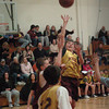Newburyport: George Troupe of the UCLA Bruins goes for a shot past the Yukon Huskies. Bryan Eaton/Staff Photo