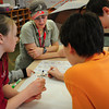 Erin Shea, an MIT graduate stuident in geology, specializing in geochronology and paleomagnetism<br /> works with students in David Williams' fourth grade class at the Newbury Elementary School on questions of magnatism. Bryan Eaton/Staff Photo