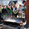Amesbury: Maple syrup maker Chris Hicks of Plaistow shows Sparkhawk School students how he makes the sweet condiment bringing a portable evaporator to their Amesbury campus. The younger children had their own bags attached to maple trees around the area and emptied it into a bucket which he added to the boiling sap. Bryan Eaton/Staff Photo