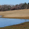 Amesbury: People walking their dogs at Woodsom Farm in Amesbury now have waterfront property to enjoy the outdoors, at least temporarily. Melting snow created a good-sized pond over part of the soccer fields. Bryan Eaton/Staff Photo