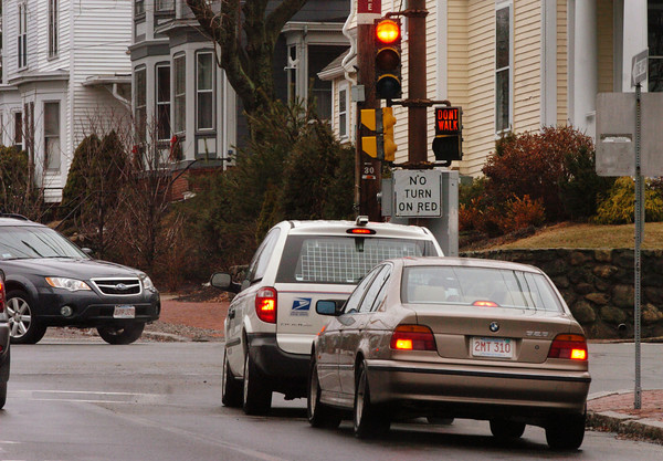 "Newburyport: Vehicles, right, on State Street wait to turn right onto High Street in Newburyport. The sign posted says ""no turn on red"" but there is no official traffic rule to back up the sign which people sometimes ignore. Bryan Eaton/Staff Photo"