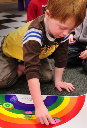 Newburyport: Patrick Lehan, 5, matches fruit colors to that of the rainbow. Bryan Eaton/Staff Photo