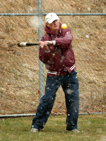 Newburyport: Newburyport High baseball coach Bill Pettingell<br /> hits balls to the outfield as the season got underway yesterday. Bryan Eaton/Staff Photo