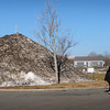 Newburyport: The top of the Towle Building on Merrimac Street in Newburyport can be barely made out over the huge snow piles the city deposited at Cashman Park. Spring arrives Sunday, though it could be awhile before all the dirty snow melts. Bryan Eaton/Staff Photo