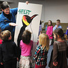 Newburyport: Volunteer Meg Atkins shows children just how tall they'd be compared to an emperor penquin at the Newburport Montessori School on Tuesday morning. She came along with Lisa Hutchings from Audubon Society Joppa Flats Education Center to teach the children about the birds from Antarctica. Bryan Eaton/Staff Photo