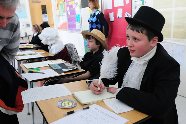 "Seabrook: Connor Allen, 11, portrays Thomas Paine, patriotic writer of the Revolutionary War, during a living wax museum at Seabrook Middle School on Friday afternoon. Visitors pushed a ""button"" and the character would come to life for a brief presentation. Bryan Eaton/Staff Photo"