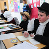 """Seabrook: Connor Allen, 11, portrays Thomas Paine, patriotic writer of the Revolutionary War, during a living wax museum at Seabrook Middle School on Friday afternoon. Visitors pushed a """"button"""" and the character would come to life for a brief presentation. Bryan Eaton/Staff Photo"""