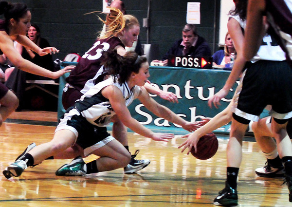 West Newbury: Pentucket's Victoria Castiglione dives for a loose ball last night against Weston. Bryan Eaton/Staff Photo