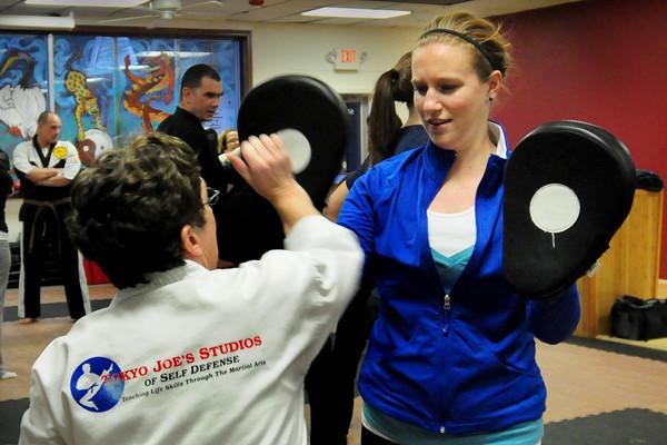 Salisbury: Kim Limoli of Merrimac strikes Daily News correspondent in a self-defense class at Tokyo Joe's Studio in Salisbury. Bryan Eaton/Staff Photo