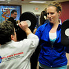 Salisbury: Kim Limoli of Merrimac strikes Daily News correspondent in a self-defense class at Tokyo Joe's Studio in Salisbury. Bryan Eaton/Staff Photo