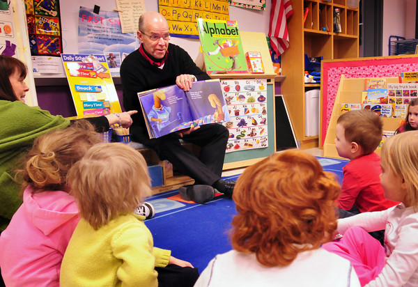 "Amesbury: Retired principal from the Cashman School in Amesbury, Peter Hoyt, reads ""Llama Llama Red Pajama"" to kindergartners there yesterday morning. He was participating in ""Read Across America Week"" which coincides with the birthday of Dr. Seuss. Bryan Eaton/Staff Photo"