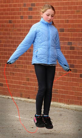 Amesbury: While some children chose to slide in the snow that remains next to Amesbury Elementary School, Sophia Carter, 9, opted for some jump roping on the pavement. She was at the Amesbury Recreation Department's Afterschool Program. Bryan Eaton/Staff Photo