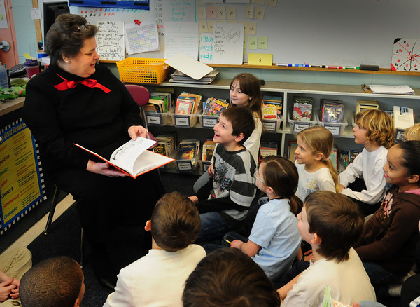 "Newbury: Grace Ruhp reads ""Bartholomew and the Oobleck"" by Dr. Seuss to third-graders at the Newbury Elementary School on Wednesday. The former teacher, who retired from the school last year, was one of the readers on hand for the school's Read Across America. Bryan Eaton/Staff Photo"