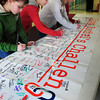 Newburyport: Students sign the Rachel's Challenge mural after a presentation. From left, Krysta Padellaro, Gabby Balkind, Kate Costello, all 10, and Adam Raymond, 11. Bryan Eaton/Staff Photo