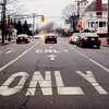 "Newburyport: Vehicles heading south on State Street in Newburyport at High Street at a red light prepare to turn left, go straight or take a right yesterday afternoon. Those taking a right, face a sign that says ""no right turn on red"" though there is no city traffic law that forbids such. Bryan Eaton/Staff Photo"