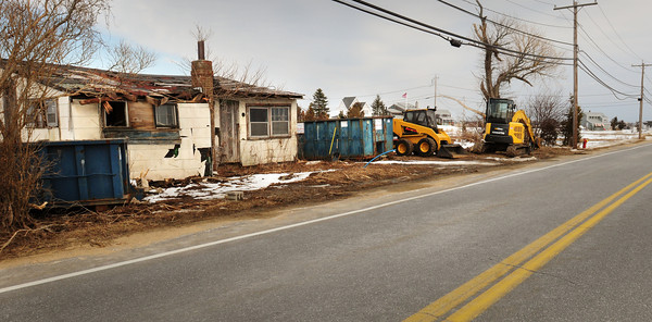 Newbury: One of the buildings being demolished on the Plum Island Turnpike just west of Plumbush Downs. Bryan Eaton/Staff Photo